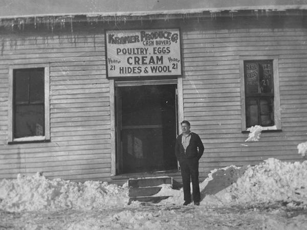 Founder Freeman Kramer in front of original store - Late 1930s
